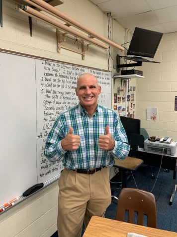 Mr. Walther flashes a smile on his first day back at school.