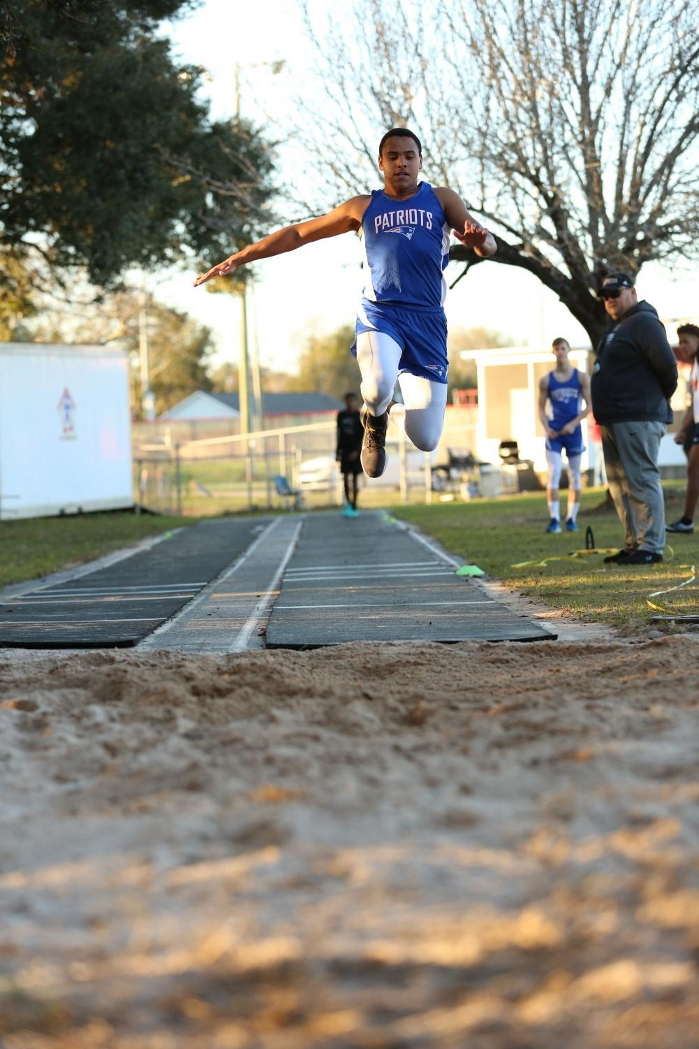 Sean Donaldson participates in the long jump event at a home track meet.