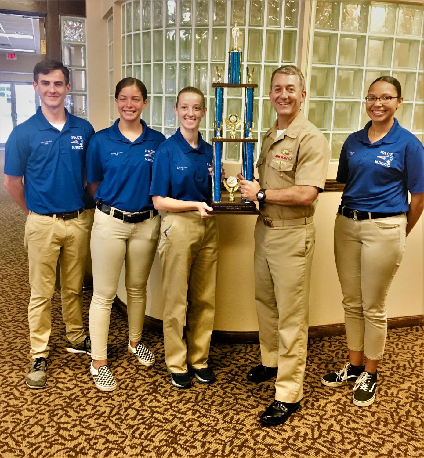 NJROTC leadership members accept the Most Outstanding Unit award.